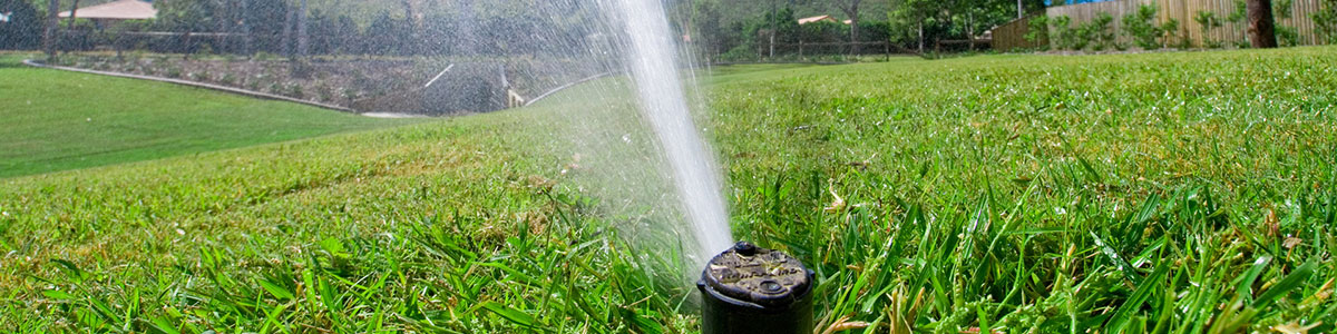 green lawn, lawn aeration, underground sprinklers, sprinkler heads, retaining walls, landscaping materials